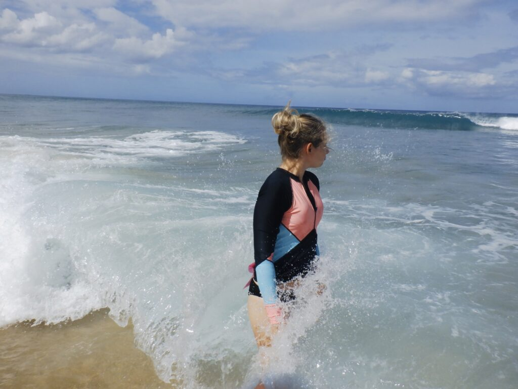 Amy getting into the water at Electric Beach